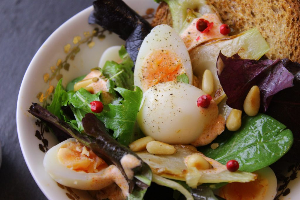 Quail egg salad with mixed leaves and pine nuts