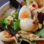 Peppery salad with quail eggs, roasted fennel and toasted pine nuts