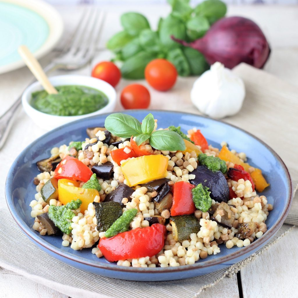 Fregola with vegetables and pesto