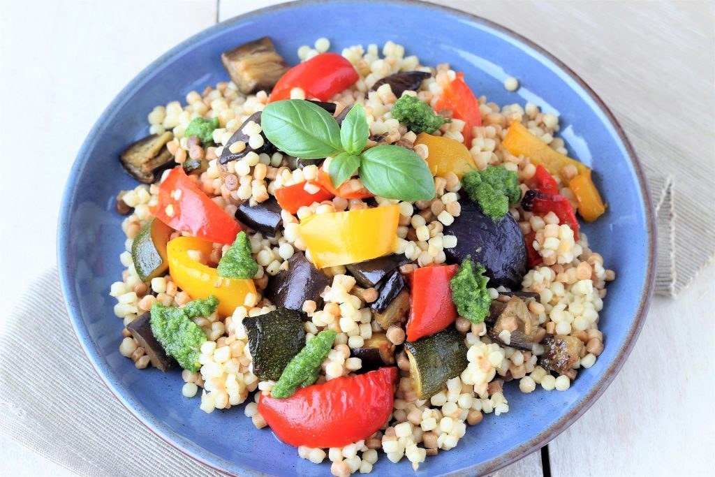 Fregola with peppers and courgettes - flatlay
