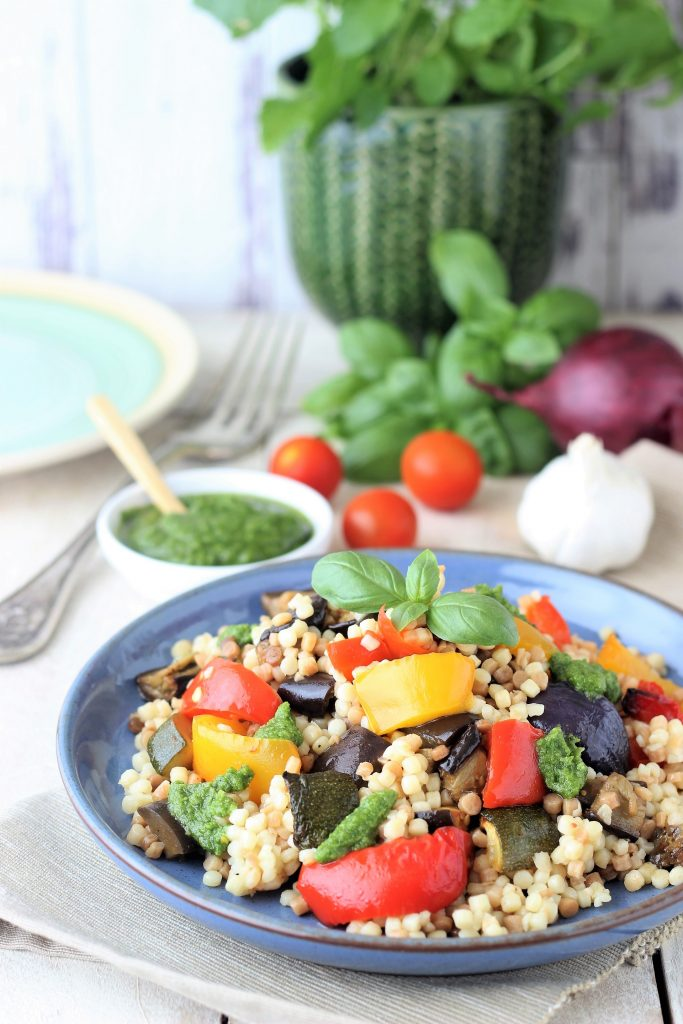 Fregola with pesto and veggies on the table