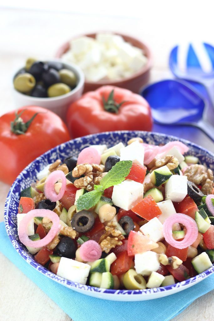 Greek salad with olives, tomato and onion