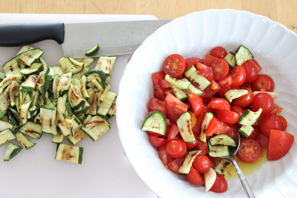 Cutting tomatoes and courgettes