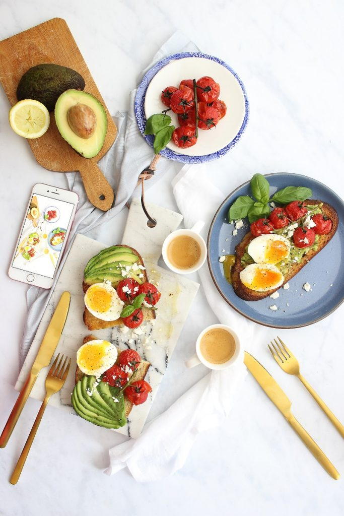 Avocado toast with cherry tomatoes - flatlay