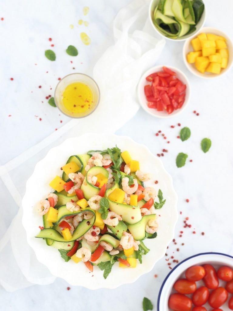 Prawn, mango, courgette and tomato salad with maple syrup dressing - flat lay