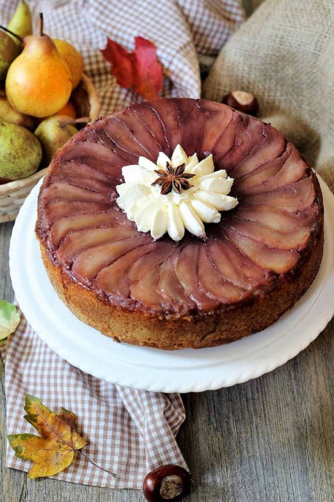 Upside down pear cake with red wine spiced syrup