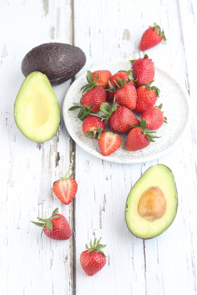 Avocado and strawberries - flatlay