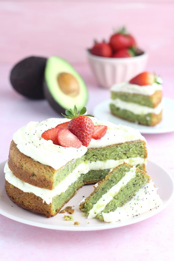 Avocado cake with frosting and strawberries
