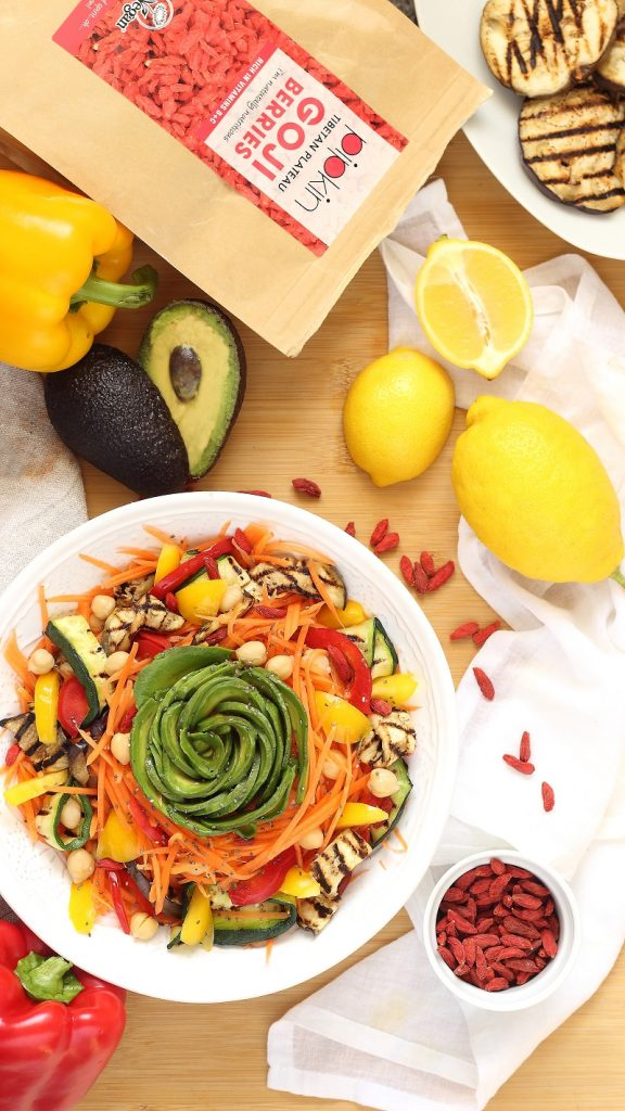 Roasted vegetable and goji berries salad flat lay