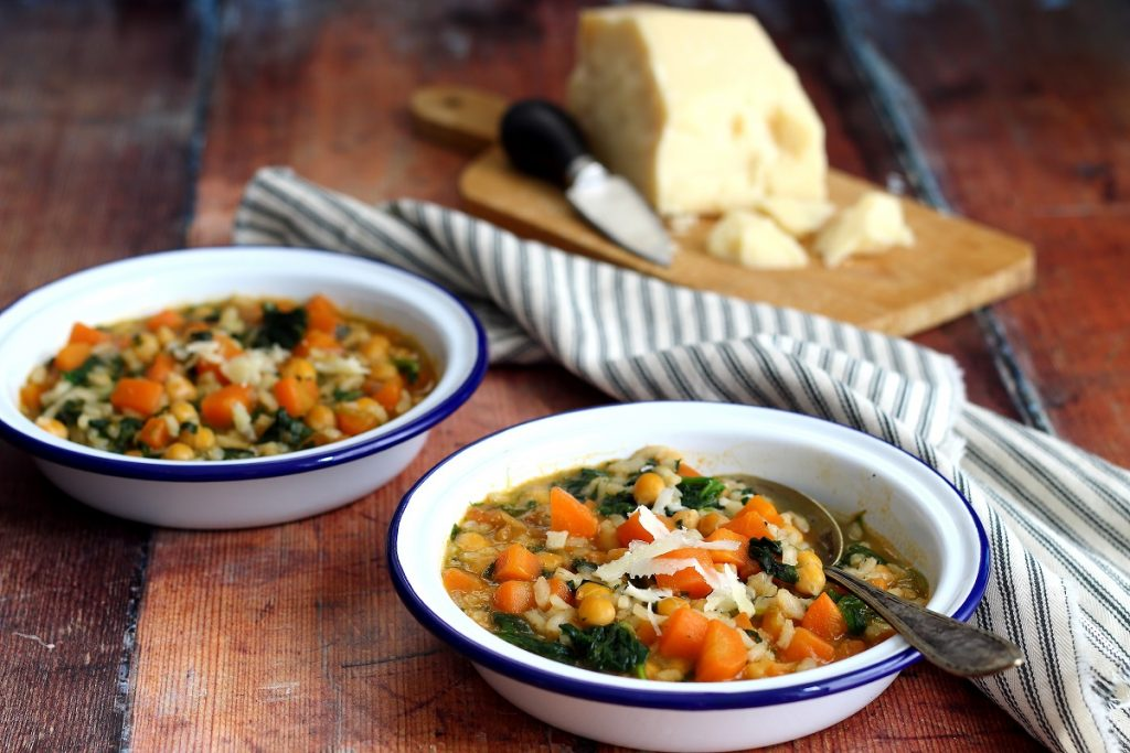Carrot, spinach, chickpeas and ginger soup with Parmesan