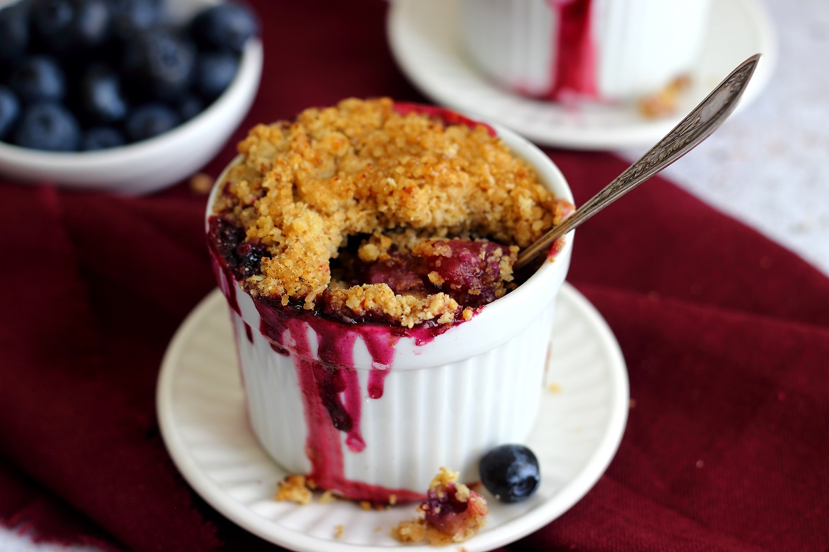 Apple and blueberry crumble close up - header